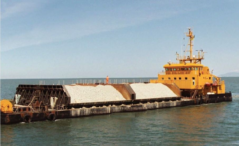 barge with sidewalls carrying sand