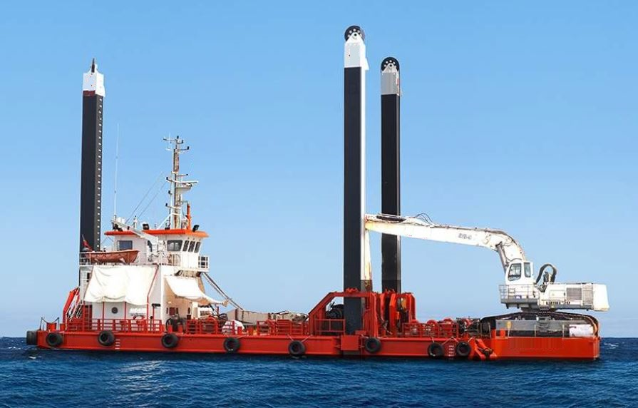Dredger with spuds and excavator